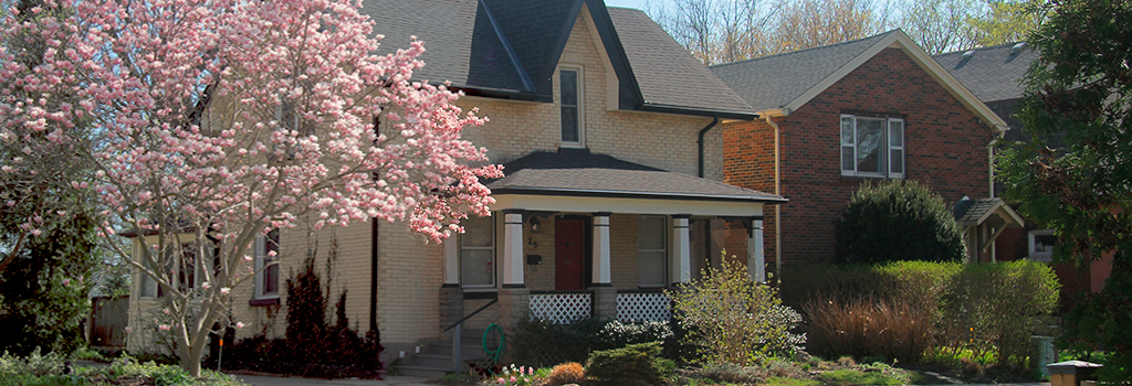 Front view of yellow brick house with magnolia tree in front - located at 25 Victor Street London, ON